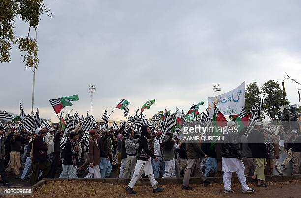 Pakistani activists from the Ahle Sunnat Wal Jamaat march during a protest against the printing of satirical sketches of the Prophet Muhammad by...