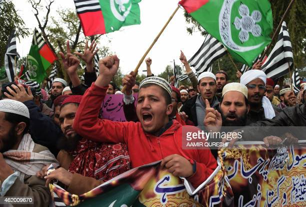 Pakistani activists from the Ahle Sunnat Wal Jamaat shout slogans during a protest against the printing of satirical sketches of the Prophet Muhammad...