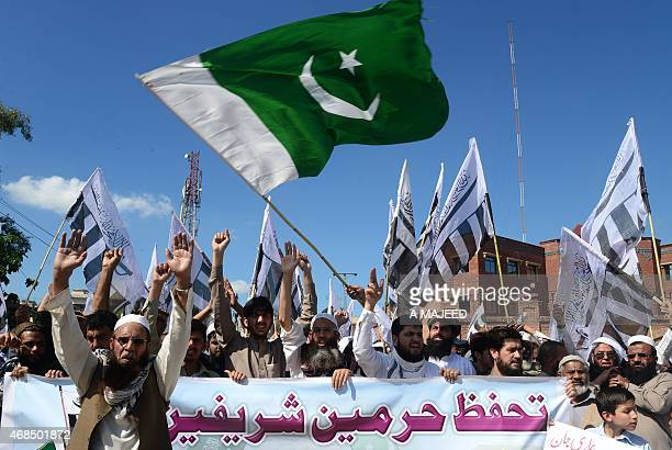 Pakistani activists from the Jamaat ud Dawa and Ahle Sunnat Wal Jamaat organisations shout slogans as they take part in a rally to support the...