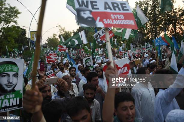 Pakistani activists from the JamaateIslami political party take part in a rally to mark the first anniversary of the death of rebel leader Burhan...