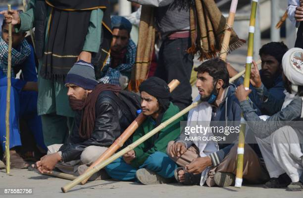 Pakistani activists from the TehreekiLabaik Yah Rasool Allah Pakistan religious group block a street during a protest in Islamabad on November 18...