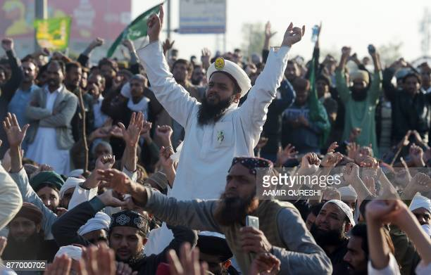 Pakistani activists from the TehreekiLabaik Yah Rasool Allah Pakistan religious group chant religious slogans during a protest in Islamabad on...
