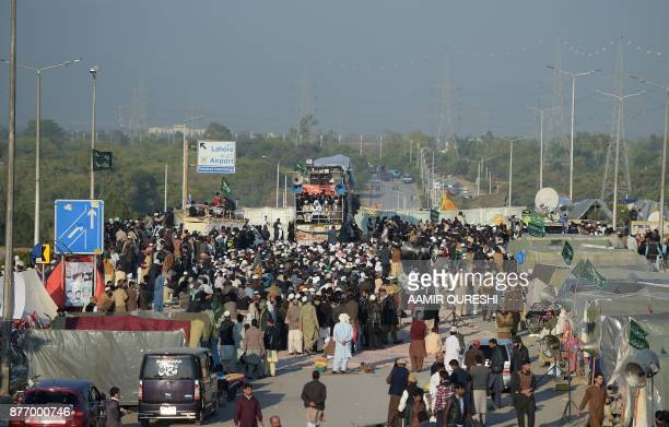 Pakistani activists from the TehreekiLabaik Yah Rasool Allah Pakistan religious group gather on a blocked flyover during a protest in Islamabad on...