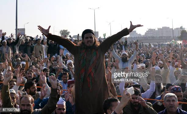 Pakistani activists from the TehreekiLabaik Yah Rasool Allah Pakistan religious group chant religious slogans on a blocked flyover during a protest...