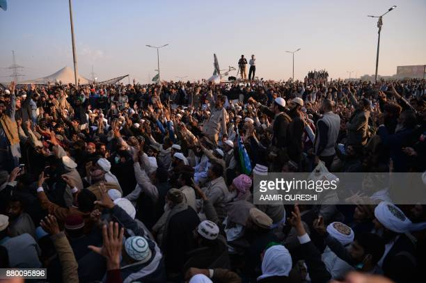 Pakistani activists from the TehreekiLabaik Yah Rasool Allah Pakistan religious group shout slogans at the end of a protest in Islamabad on November...