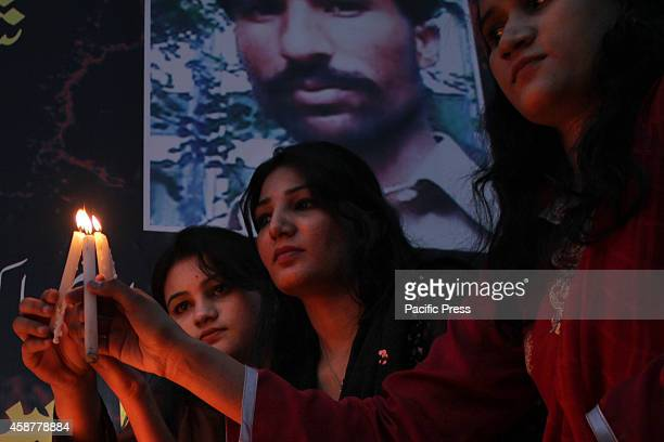 Pakistani Activists from the 'Voice of Christian International' light candles in memory of the couple who were allegedly killed in a mob...