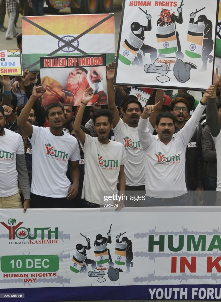 Pakistani activists of a youth forum for Kashmir march to mark the