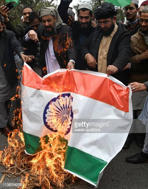 Pakistani activists of Ahle Sunnat Wal Jamaat party put an Indian flag on fire as they shout slogans during an antiIndian protest in Islamabad on...