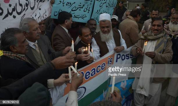 Pakistani activists of Bhagat Singh Memorial Foundation light candles during a protest in favor of PakIndia friendship outside Lahore Press Club in...