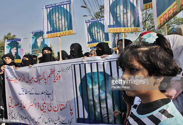 Pakistani activists of civil society and Afia movement hold a demonstration to free the arrested Dr Aafia Siddiqui from the New York prison before...