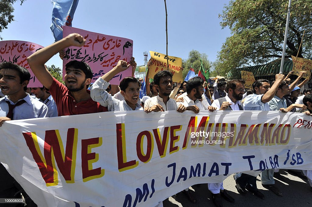 Pakistani activists of Islami Jamiat-e-Tulaba (IJT), a student wing of hardline party Jamaat-i-Islami (JI), shout slogans during a protest in Islamabad on May 20, 2010, against the published caricatures of Prophet Mohammed on Facebook. Pakistan blocked access to the popular video website YouTube in a bid to contain 'growing sacrilegious' material one day after banning Facebook for a similar reason, officials said.