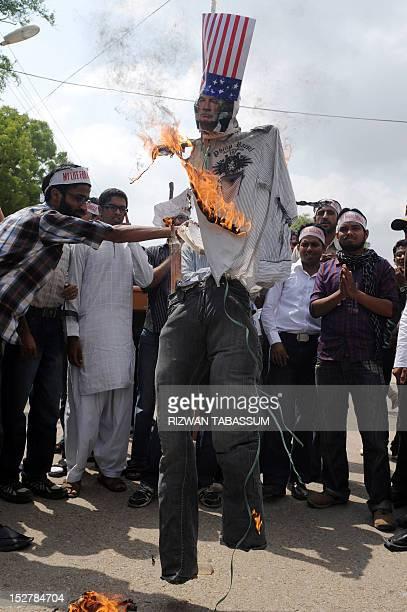 Pakistani activists of Islami JamiateTulaba a student wing of fundamentalist party JamaatiIslami burn an effigy of a US pastor Terry Jones during a...