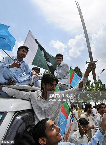 Pakistani activists of Jamiat Tulba Islam a student wing of fundamentalist Islamic party of JamaatiIslami shout slogans as they waves flags during a...