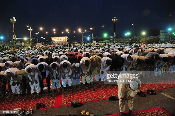 Pakistani activists of Tehreek-e-Insaf party offer prayers during an anti-government rally in Islamabad on August 6, 2011. Pakistani...