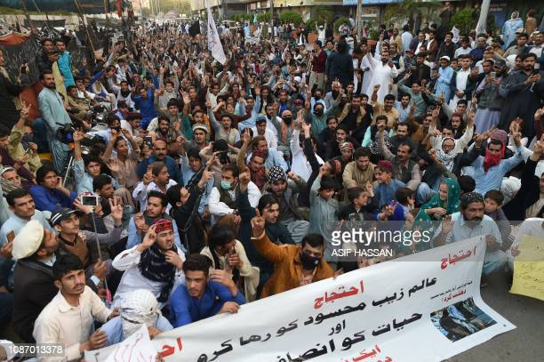 Pakistani activists of the Pashtun Protection Movement take part in a protest against the arrest of party leader Alamzeb Mehsud in Karachi on January...
