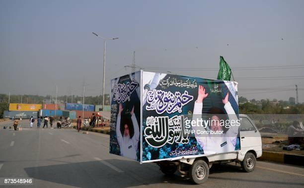 Pakistani activists of the TehreekiLabaik Yah Rasool Allah Pakistan religious group gather along a highway blocked with containers during a week long...