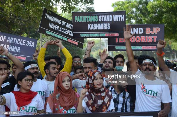 Pakistani activists of Youth forum for Kashmir chant antiIndia slogans during a protest held to oppose abrogation of Article 35A of the Indian...