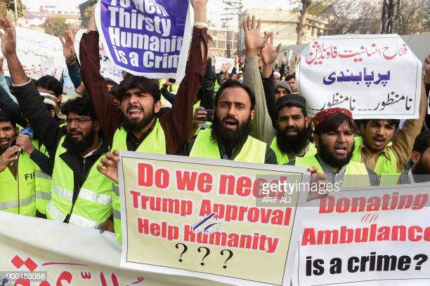 Pakistani activists with the JamaatudDawa group shout antiUS slogans at a protest in Lahore on January 2 2018 Pakistan has summoned the US ambassador...