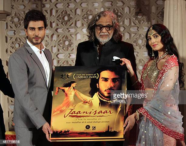 Pakistani actor Imran Abbas and Indian Bollywood actress Pernia Quershi pose with director Muzaffar Ali during the music launch for the forthcoming...