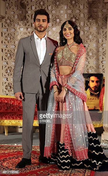 Pakistani actor Imran Abbas and Indian Bollywood actress Pernia Quershi pose during the music launch for the forthcoming Hindi film Jaanisaar...