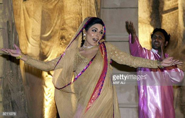 Pakistani actress Meera and an unidentified costar dance during the 46th Nigar Public Film Awards ceremony in Lahore early 03 April 2004 Wellknown...