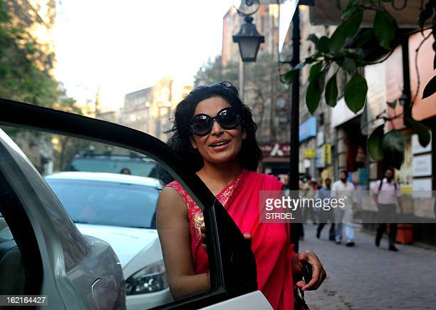 Pakistani actress Meera arrives at Amisha Mehta's art show 'Colour Dance' opening ceremony in Mumbai on February 19 2013 AFP PHOTO/ STR