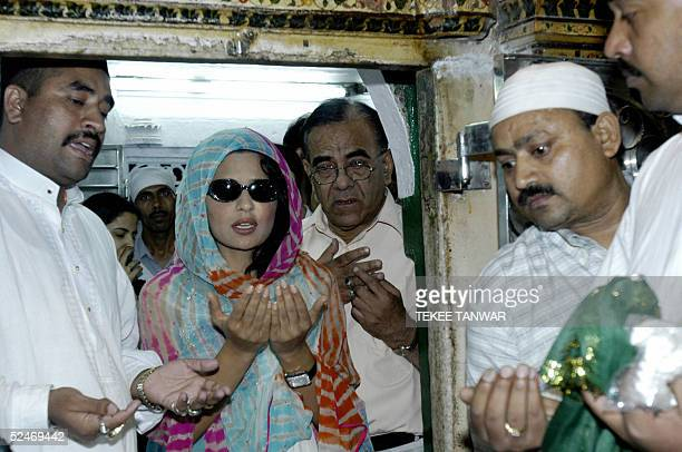 Pakistani actress Meera joins officials as she prays at the entrance to the Sufi Shrine of Hazrat Nizamuddin in New Delhi 23 March 2005 The film...