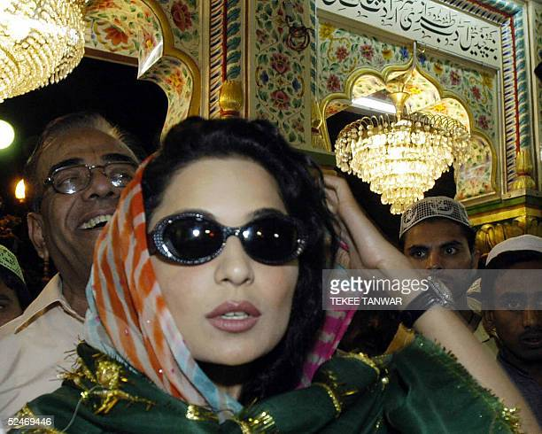 Pakistani actress Meera joins officials as she visits the Sufi Shrine of Hazrat Nizamuddin in New Delhi 23 March 2005 The film actress who...