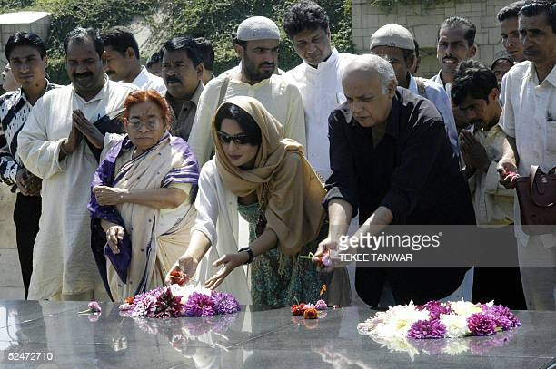 Pakistani actress Meera offers her respects with Indian film maker Mahesh Bhatt at the Mahatma Gandhi Samadhi at Rajghat in New Delhi 24 March 2005...
