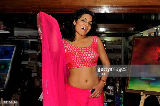 Pakistani actress Meera poses for a photo during Amisha Mehta's art show 'Colour Dance' opening ceremony in Mumbai on February 19 2013 AFP PHOTO/ STR