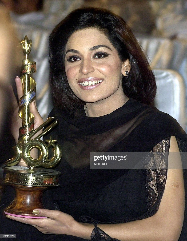 Pakistani actress Meera smiles as she holds the 46th Nigar