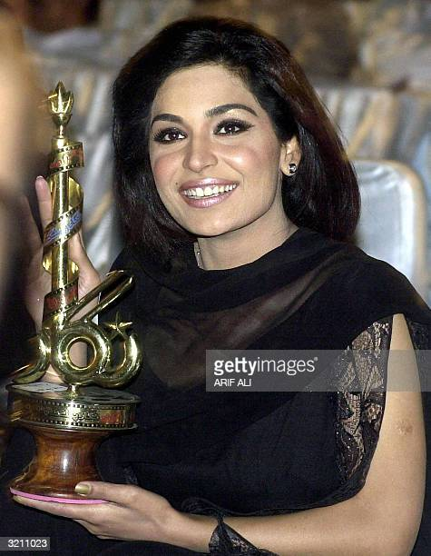 Pakistani actress Meera smiles as she holds the 46th Nigar Public Film Award for best actress during a ceremony in Lahore early 03 April 2004...