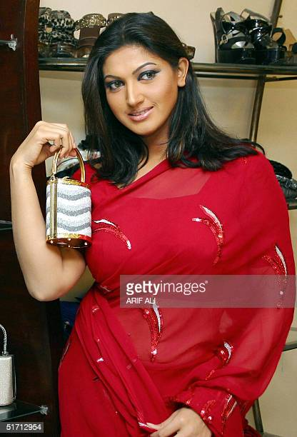 Pakistani actress Sana poses with a purse at a shopping mall ahead of the Muslim festival of Eid alFitr in Lahore 10 November 2004 Eid marks the end...