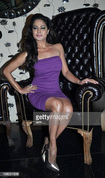 Pakistani actress Veena Malik poses as she attends Indian Bollywood actor Ashmit Patel's birthday party in Mumbai on January 13 2011 AFP PHOTO/STR