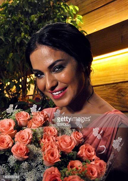 Pakistani actress Veena Malik poses during her birthday celebration in Mumbai on February 26 2012 AFP PHOTO/STR