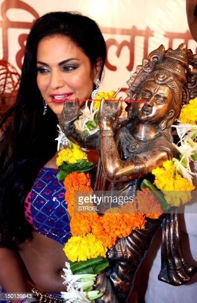Pakistani actress Veena Malik poses for a photo during celebrations of Janmashtami which marks the birth of Hindu God Lord Krishna in Mumbai on...