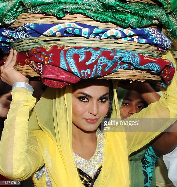 Pakistani actress Veena Malik visits the Ajmer Sharif Dargah to promote her upcoming film 'Real Life of Supermodel' in Ajmer on August 6 2013 AFP...