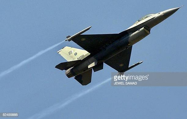Pakistani Air Force F16 fighter jet pilot displays his skills during a fulldress rehearsal for the forthcoming National Day celebrations in Islamabad...
