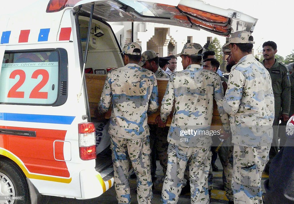 Pakistani air force personnel carry coffins of foreign tourists to an ambulance upon arrival at Chaklala airbase in Rawalpindi on June 23, 2013. Gunmen dressed as police killed nine Chinese and Ukrainian tourists in an unprecedented attack in the Pakistani Himalayas claimed by the Taliban, who said they had set up a new faction to target foreigners in revenge for US drone strikes.