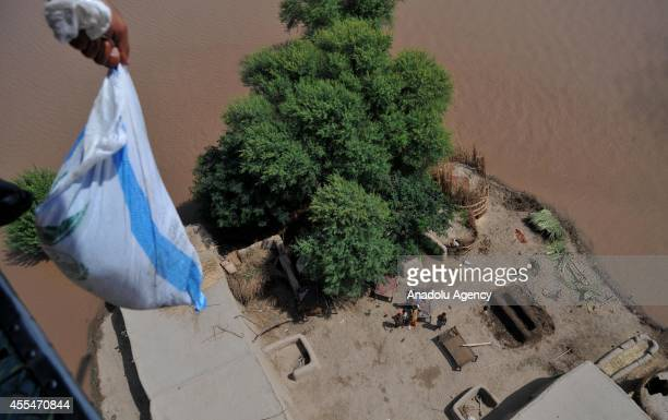Pakistani air force personnel drops relief goods for the flood victims in Multan district of the Punjab province Pakistan on September 14 2014