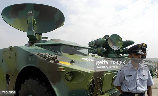 Pakistani Air Force personnel stand in front of the Crotale Weapon System displayed to mark the countrys Defence Day at the Chaklala airbase in...
