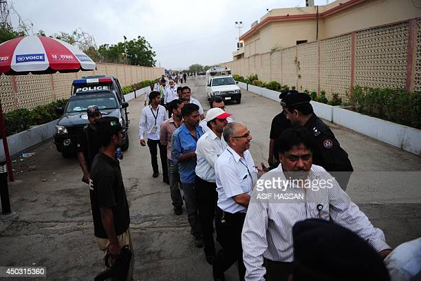Pakistani airport employees leave the Jinnah International Airport after militants attack in Karachi on June 9 2014 Pakistan's security forces said...