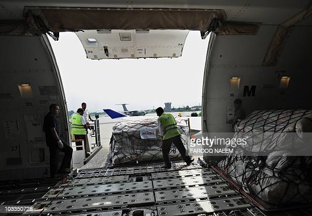 Pakistani airport employees unload relief goods donated from the United Kingdom at Chaklala Airbase in Rawalpindi on August 11 2010 The United...