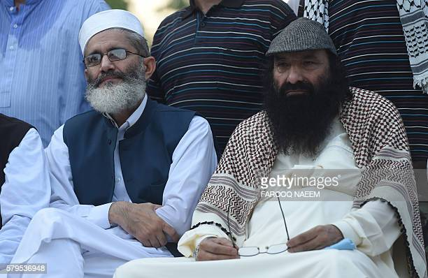 Pakistani Ameer of the Jamaat e Islami organisation Senator Sirajul Haq and Hizbul Mujahideen chief Syed Salahuddin look on during a protest against...