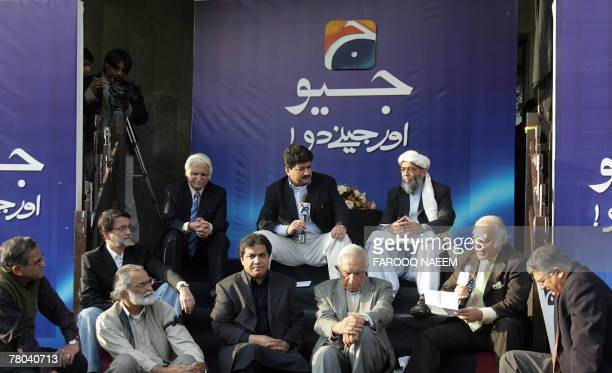 Pakistani anchor of the banned Geo television channel Hamid Mir flanked by opposition leaders sits during an open air program outside their office in...