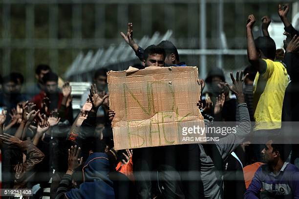 Pakistani and Afghan migrants protest against the deportation to Turkey inside the Moria detention center in Mytilene on April 5 2016 Migrants return...
