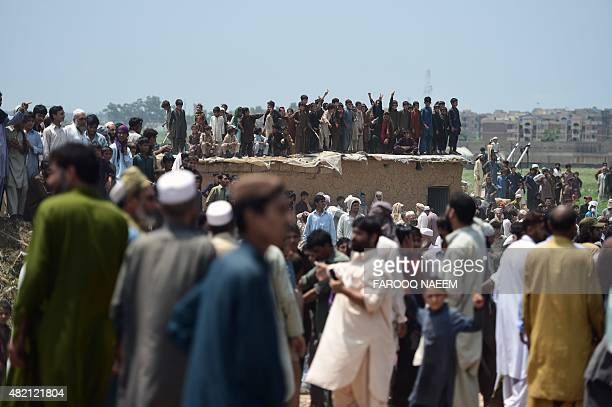 Pakistani and Afghan Pashtun people gather at a rally to defend their housing at a slum area of Islamabad on July 27 2015 A court ruling ordered the...