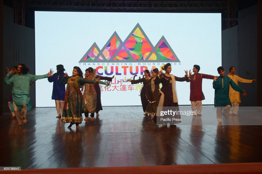 Pakistani and Chinese artist perform on stage wearing traditional outfits during the China Ancient Show of CPEC Cultural Caravan Festival organized...