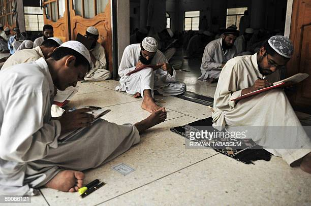 Pakistani and foreign religious students take their final exam at the Jamia Binoria madrasa in Karachi on July 18 2009 According to government...