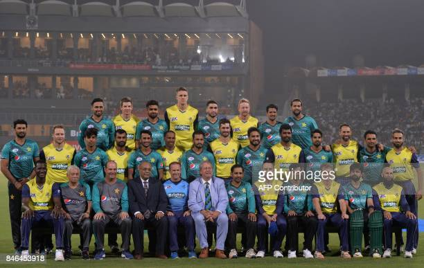 Pakistani and World XI cricket players pose for a photograph at the Gaddafi Cricket Stadium in Lahore on September 13 before the start of the second...